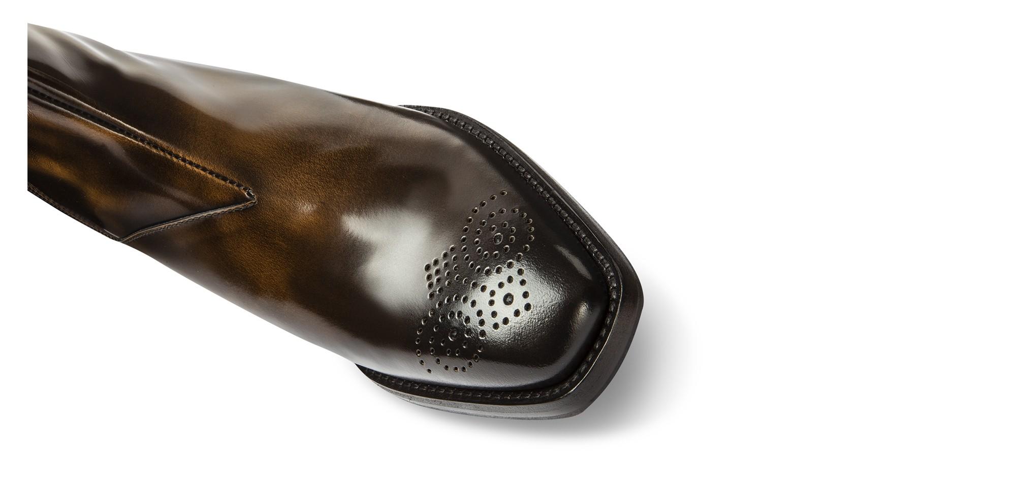 elevator chelsea boots